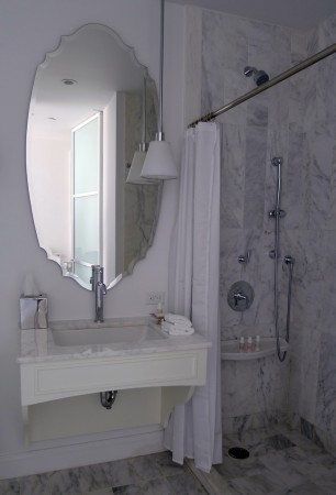 Bright bathroom with marble shower