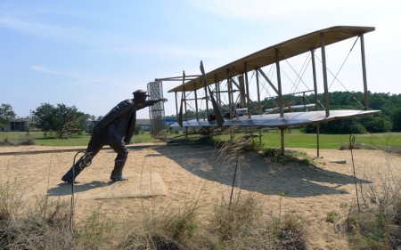 Replica of the first flight made by the Wright Brothers at the Wright Brothers Memorial in Kitty Hawk