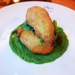 Fried zucchini flowers stuffed with anchovies, mozzarella and basil on a zucchini cream at Sirio Ristorante