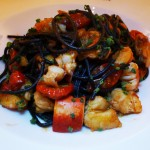 Black squid ink spaghetti made with lobster and tomato is served at Sirio Ristorante
