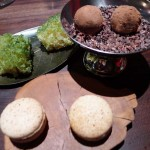 Macaroons with chocolate truffle and green tea sponge cake at Saison in San Francisco, CA