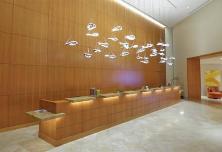 The Hotel Irvine lobby boasts a sleek modern décor